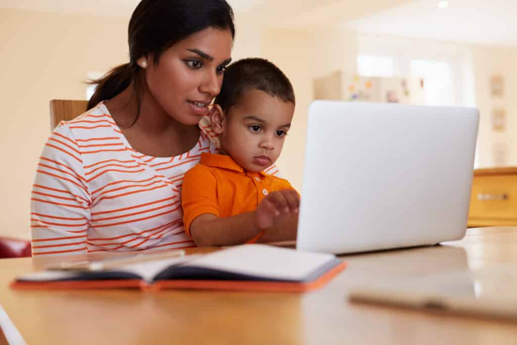 Mother helping child in studying